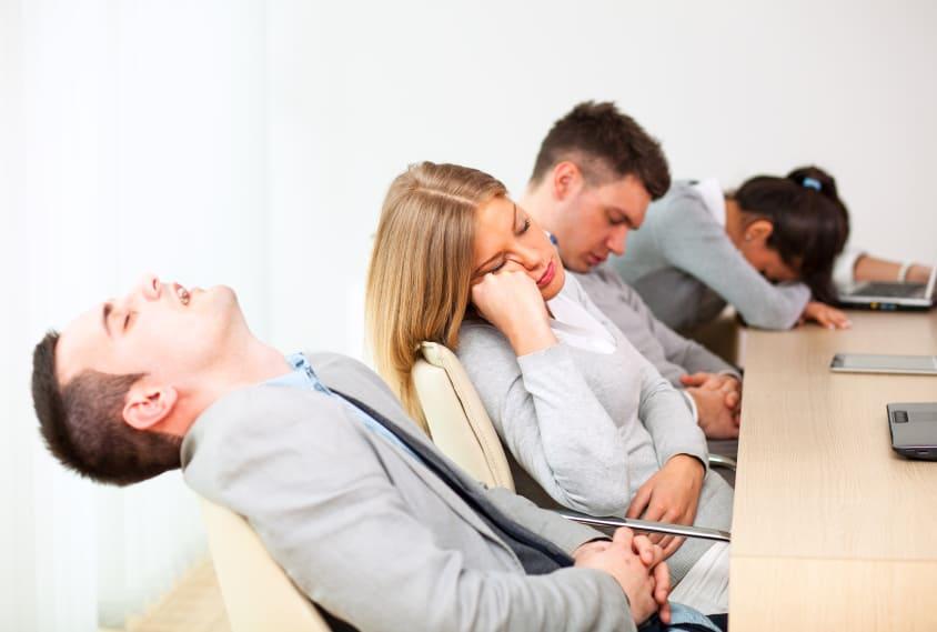 Man Sleeping in Business Meeting