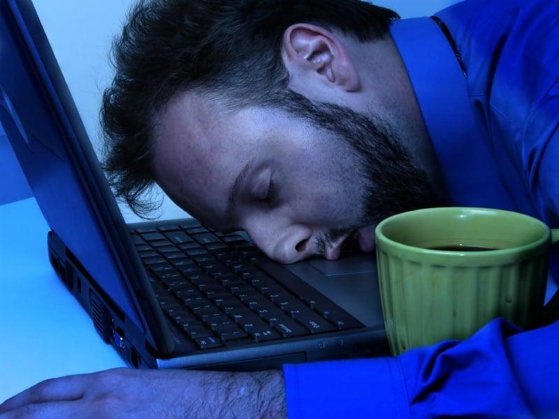 Man sleeping at laptop computer