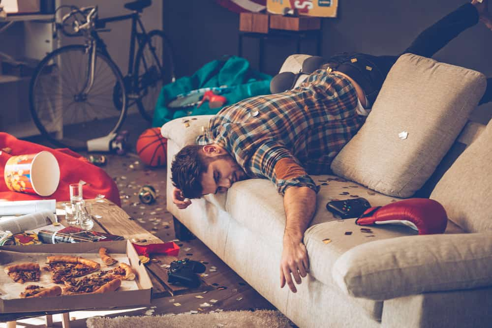Man passed out on sofa after party