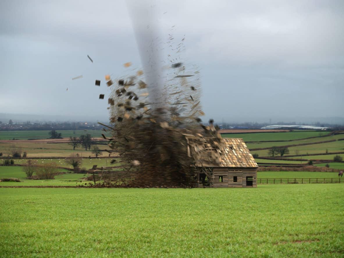 Tornado destroying a barn