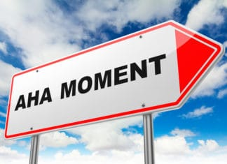 Aha moment sign with blue sky and clouds