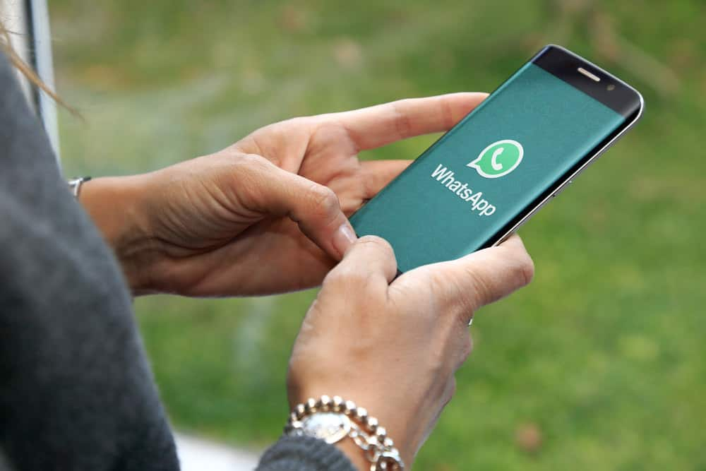 Person using whatsapp on mobile device