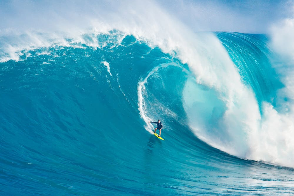 Professional surfer Carlos Burle rides a giant wave at the legendary big wave surf break