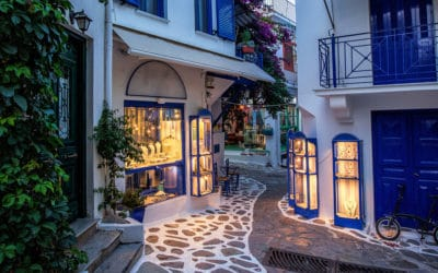 narrow alley with cobblestone in Skiathos, Greece