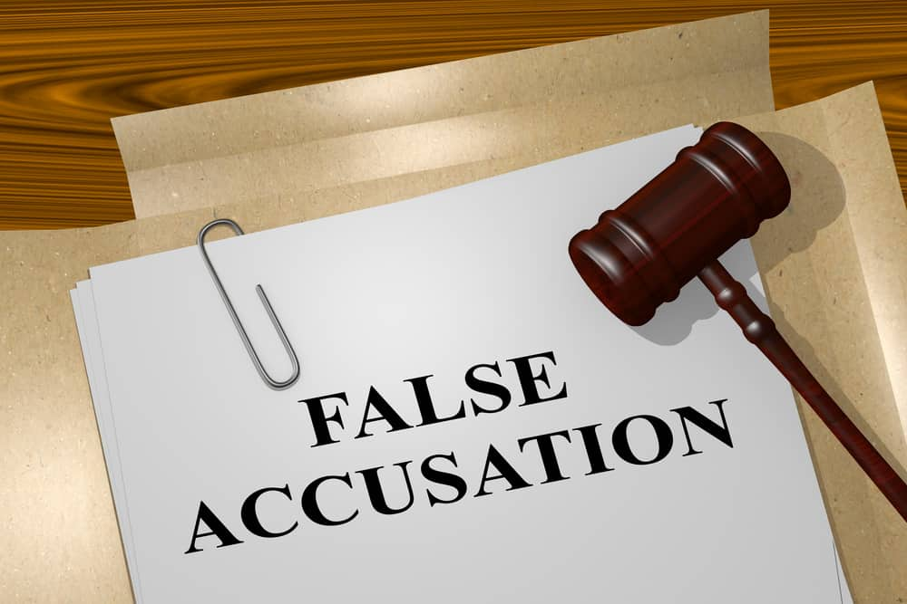 File folder with false accusation on it