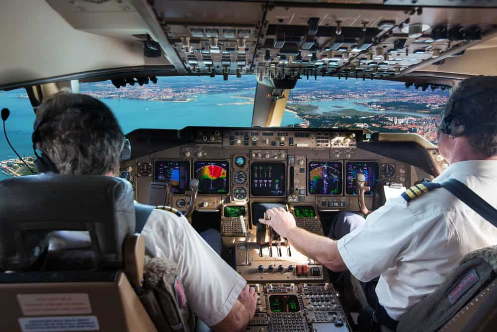 Pilots in cockpit flying commercial jet