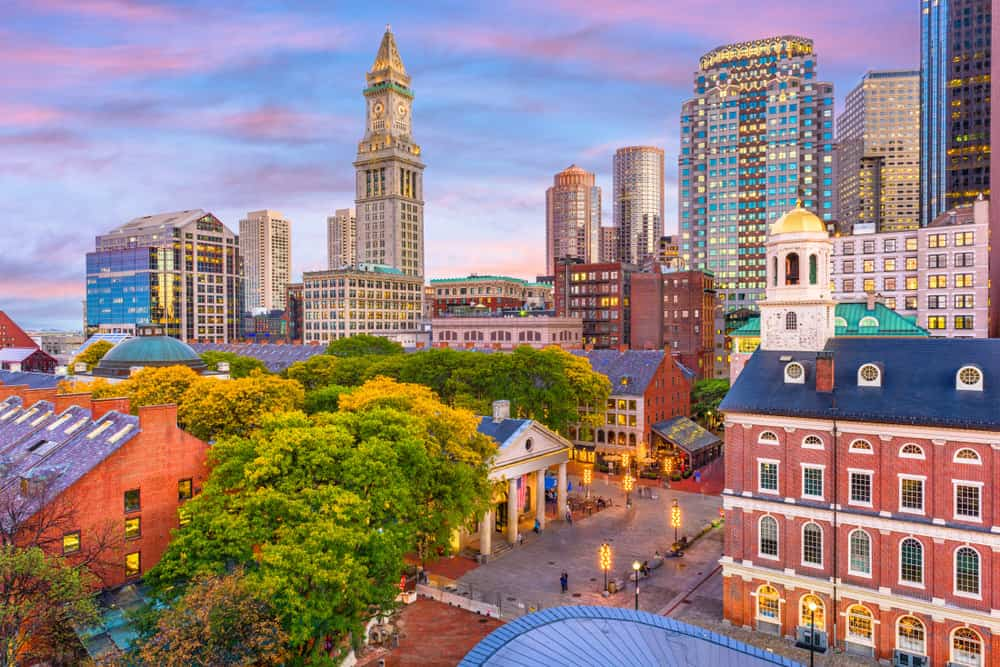 Boston, Massachusetts, USA skyline with Faneuil Hall and Quincy Market at dusk