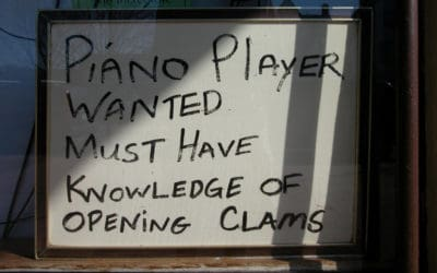 Funny sign for hiring piano player