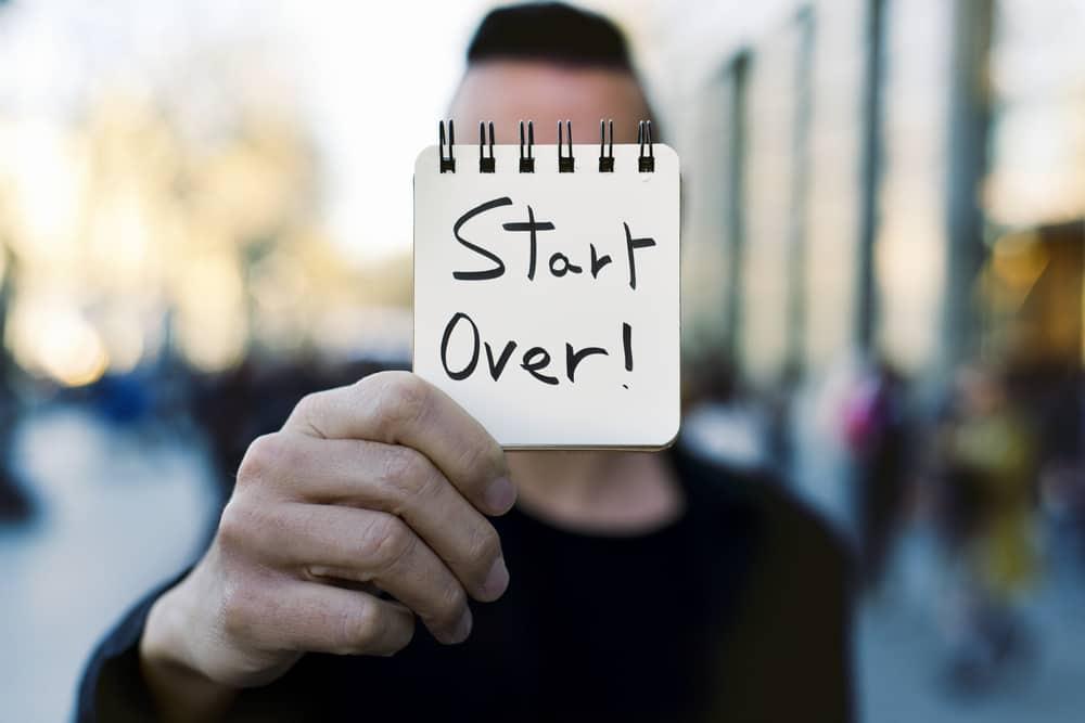 Man holding start over sign