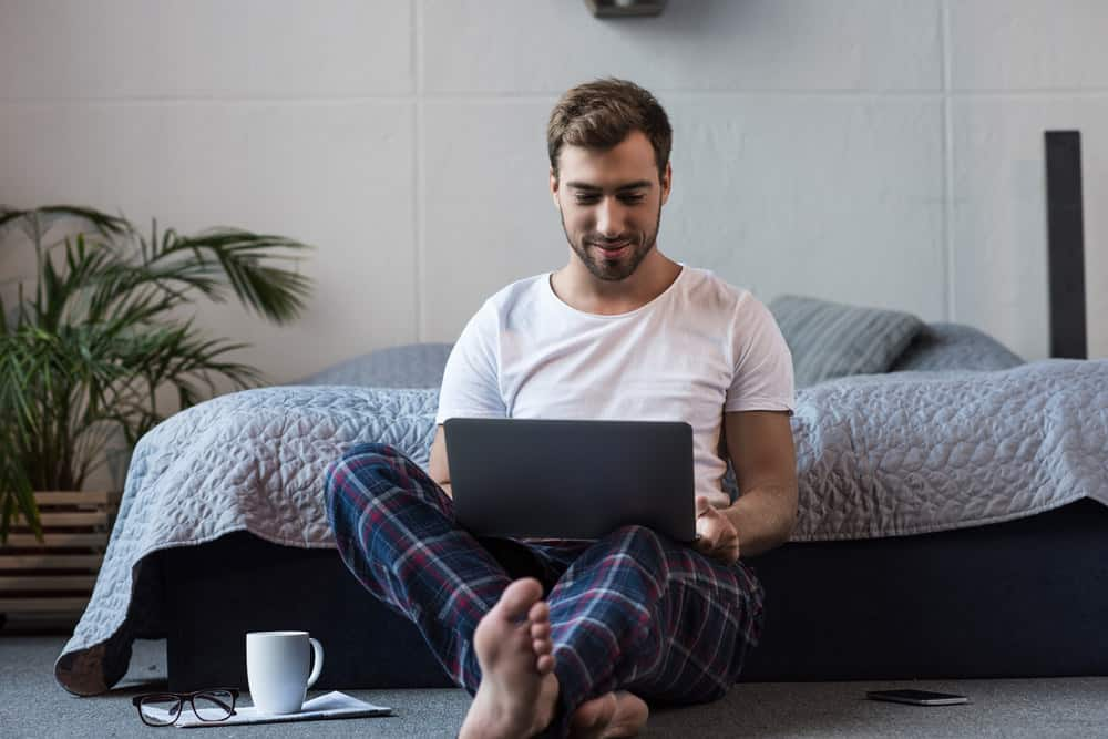 Man working from home in bedroom