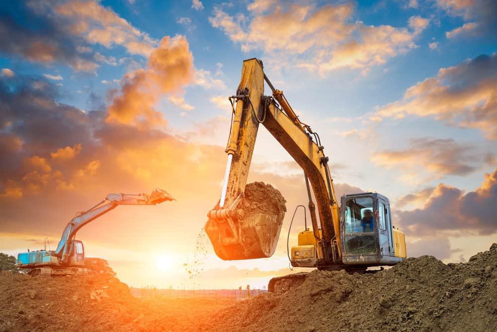 Excavator shoveling dirt