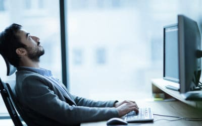 Man bored at computer