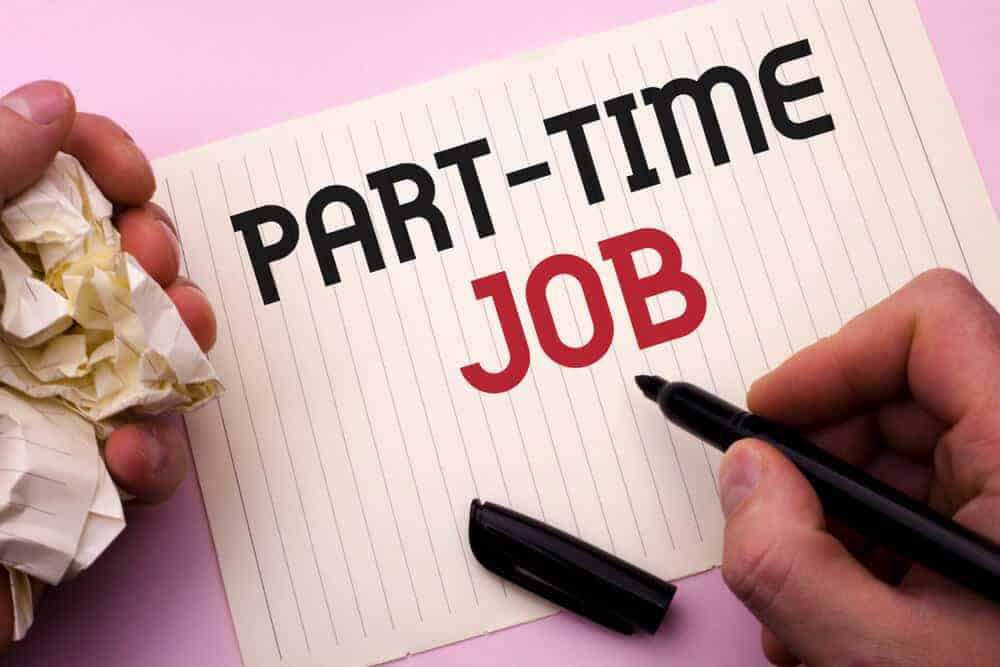 """""""Part-time job"""" written on a piece of paper using a marker."""