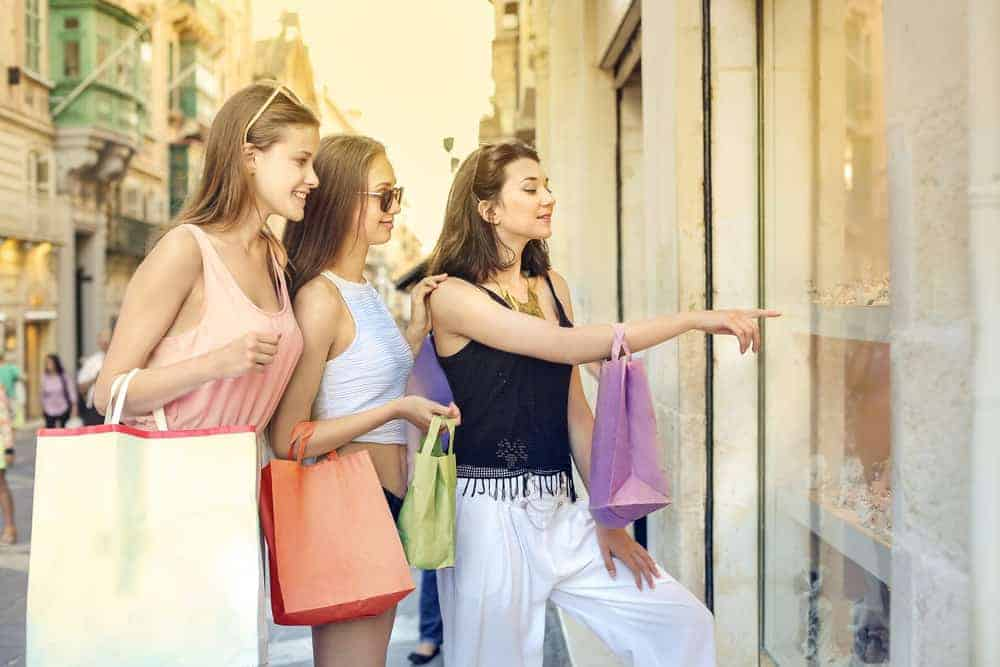 Discretionary teenage consumers shop for clothes.