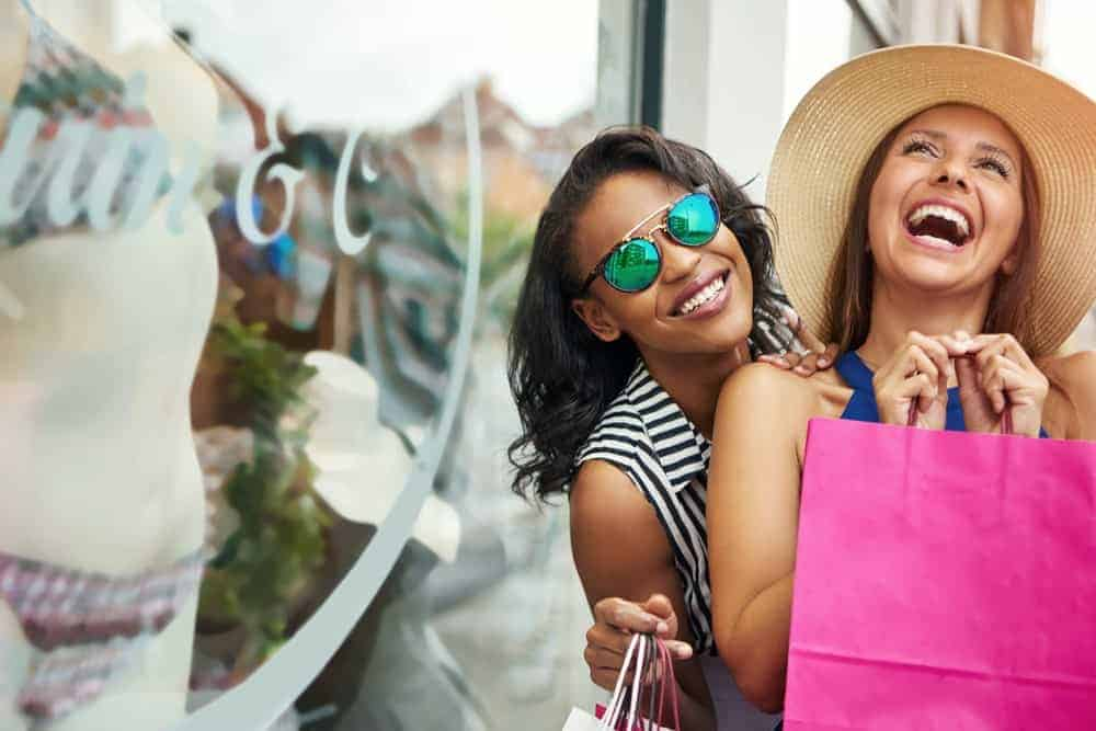 Extroverted consumers pose happily after getting their shopping fix for the day.