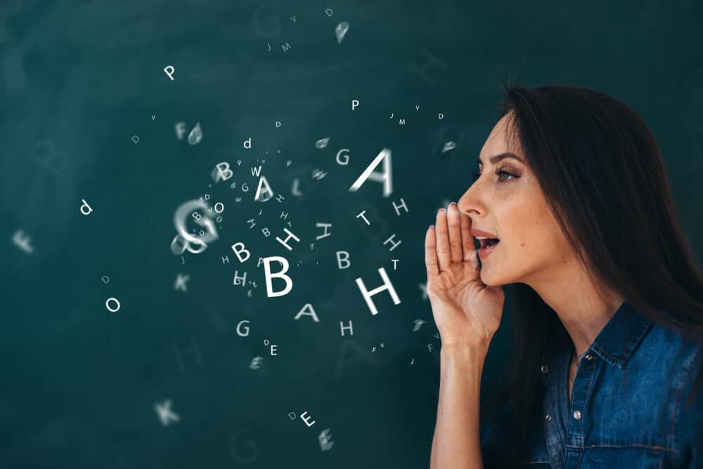 Letters coming from the woman's mouth to visualize speech.