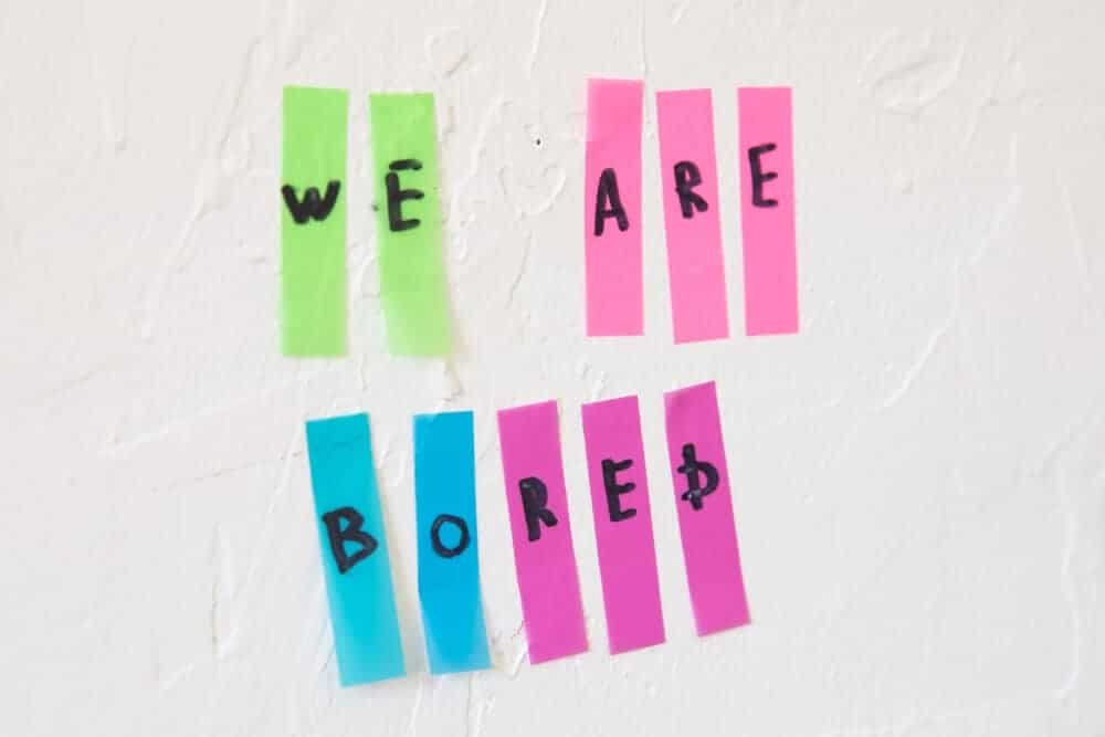 """""""We are bored"""" written.on thin strips of sticky notes."""