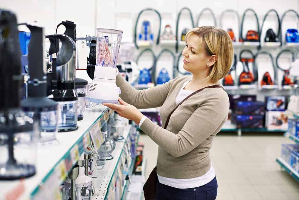 A woman shopping for personal household items.
