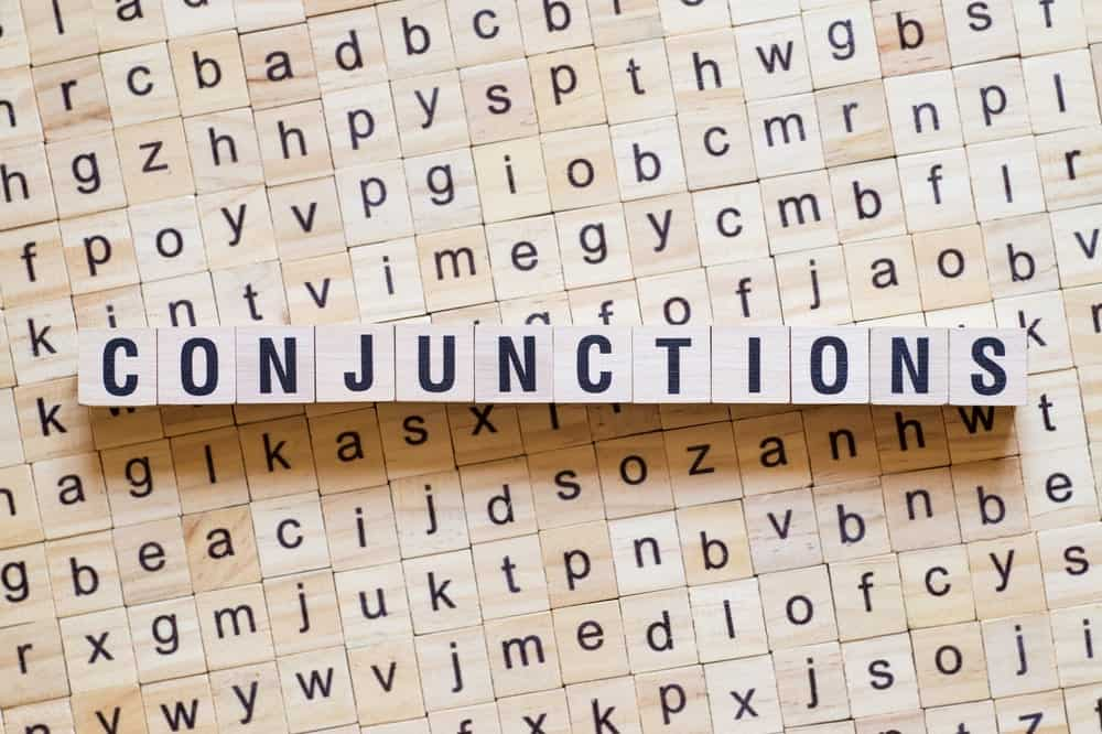 """Word """"conjunctions"""" formed from wooden cubes."""