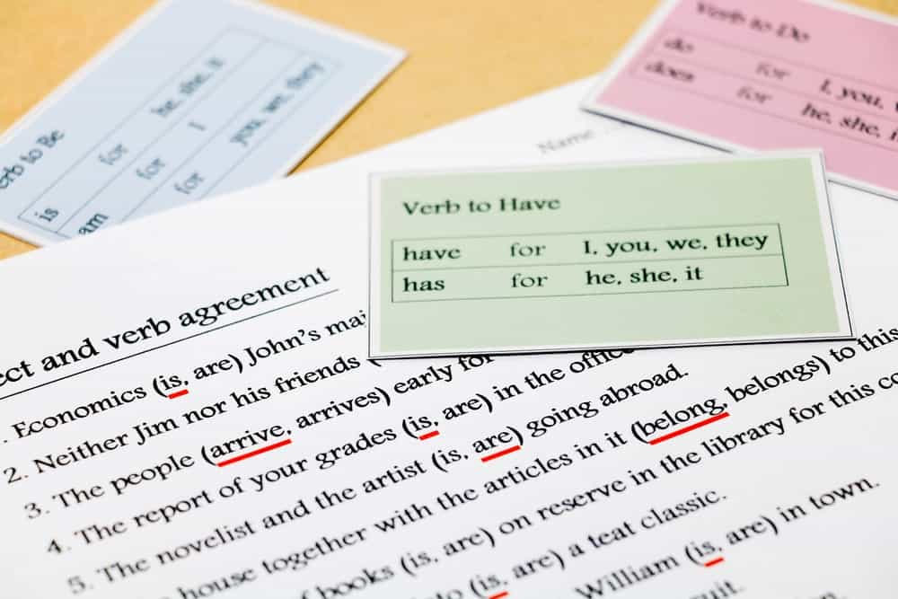 Subject and verb agreement exercise with multicolored grammar cards.