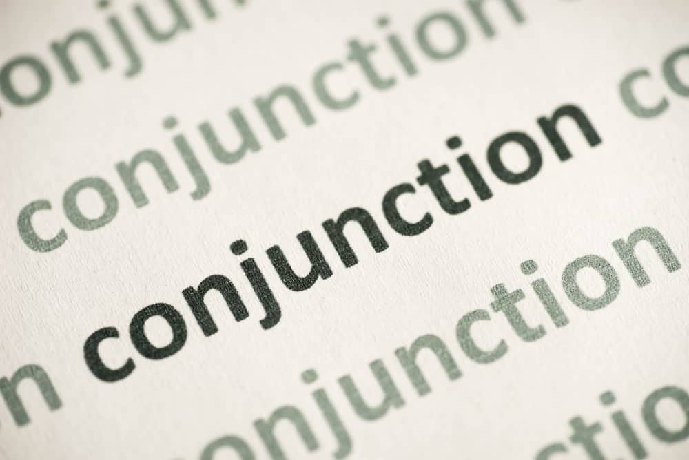 """Word """"conjunction"""" printed on white paper."""