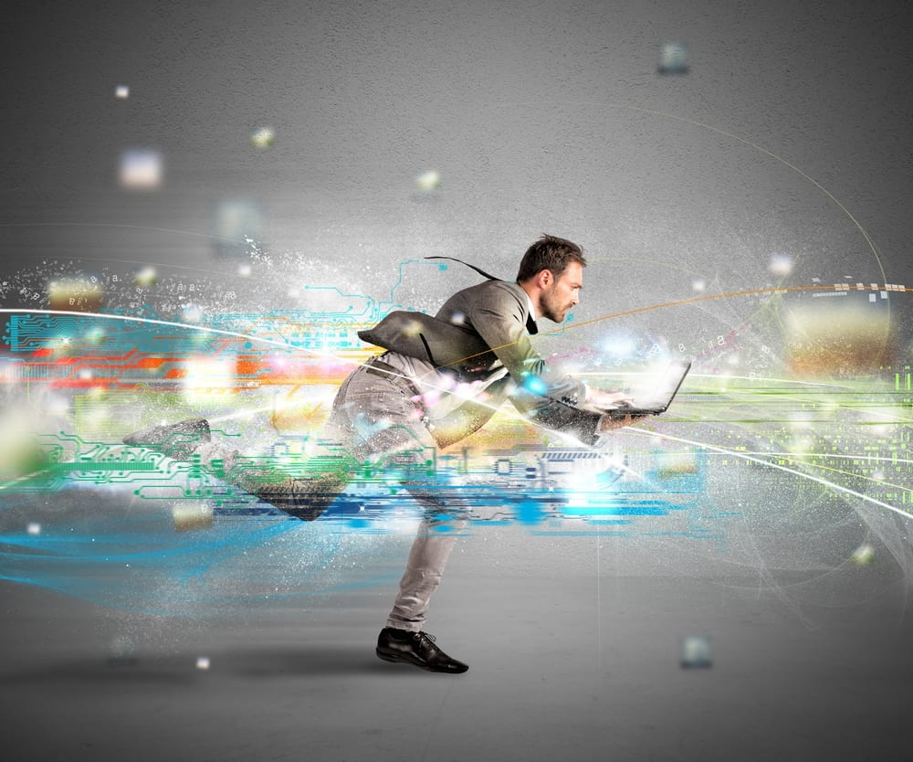 Man working on his laptop running amidst flashes indicating speed or fast internet.