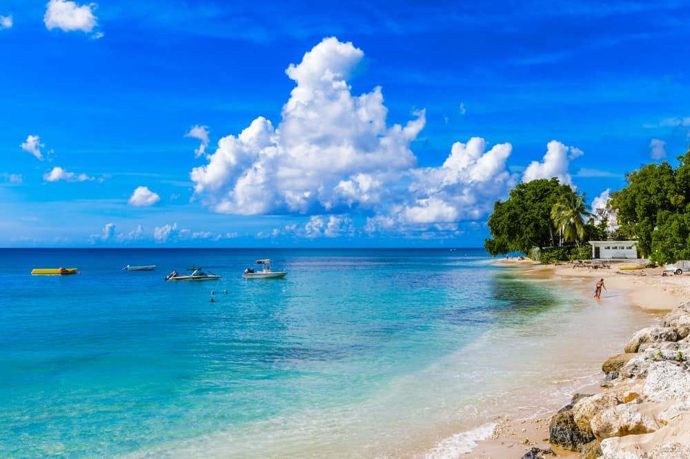 Large white clouds on a blue sky above the stunning Carribean sea.
