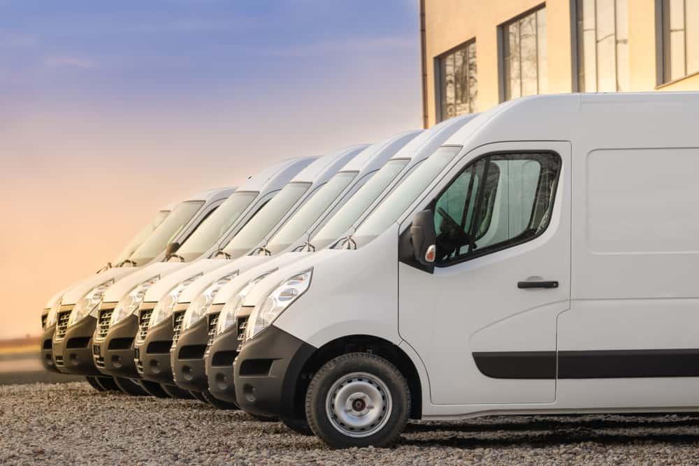 A row of white minivans.